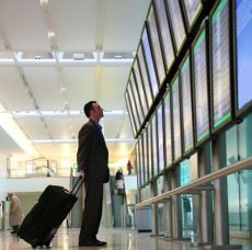business-traveler-at-airport-redim480